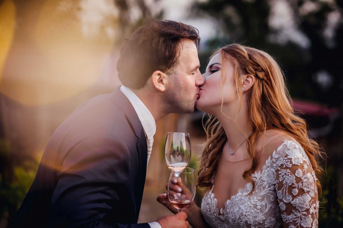 Couple drinking wine at their wedding